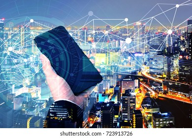 businessman using smartphone with connected polygonal dots
