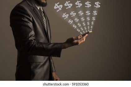 Businessman using smartphone with with money symbol coming out from the screen, symbolizing making money online