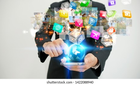 Businessman using smartphone. World connected, social media concept