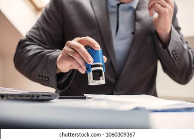 Businessman using stamp.
