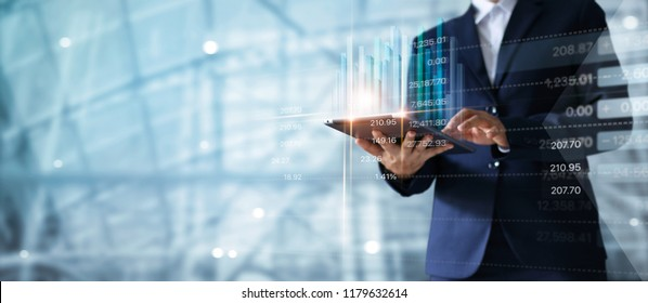 Businessman using tablet analyzing sales data and economic growth graph chart.  Business strategy.  Digital marketing.