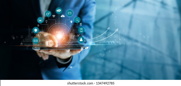 Businessman using tablet analyzing sales data and economic growth graph chart, Technology and icon customer global network connection. Business strategy. Innovative. Digital marketing.