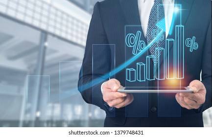 Businessman using tablet analyzing sales data and economic growth graph chart.  Business strategy. Abstract icon. Digital marketing.