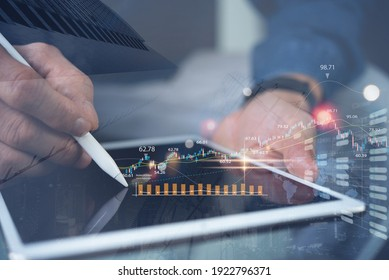 Businessman using tablet analyzing sales data and economic growth chart. Business man monitoring on stock market report, internet trading on smart phone apps with financial graph on virtual screen