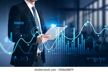 Businessman using tablet with business report hologram. Business and financial success concept. double exposure. Forex Chart