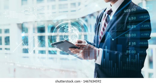 Businessman using tablet computer for analysis chart data of stock market.