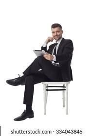 Businessman using tablet computer Full Length Portrait isolated on White Background