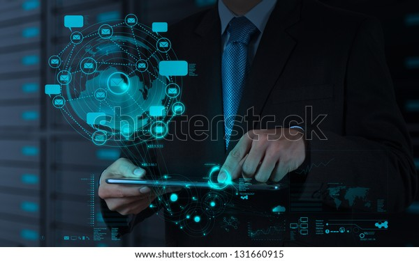 businessman using tablet computer shows internet and social network as concept