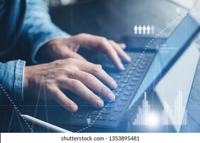 Businessman using tablet device and electronic pen stylus while working at office.Closeup view of male hands pointing tablet screen and typing keyboard