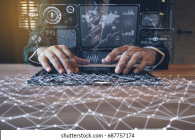 businessman using tablet PC and information communication technology concept. IoT(Internet of Things). GUI(graphical user interface). paperless office.