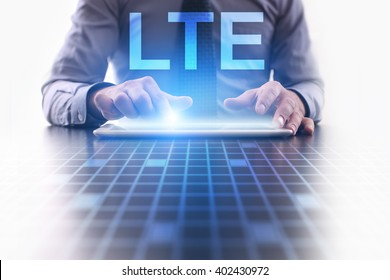 Businessman using tablet pc and select LTE.