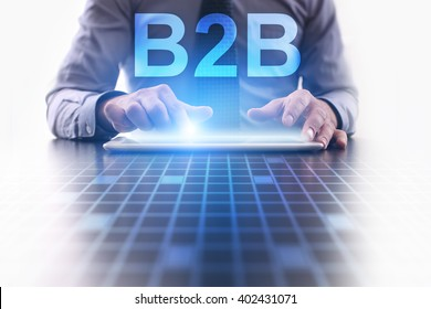 Businessman using tablet pc and select B2B