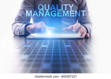 Businessman using tablet pc and select Quality management.