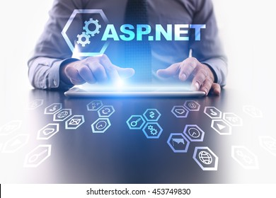 Businessman is using tablet pc and selecting ASP.NET icon.