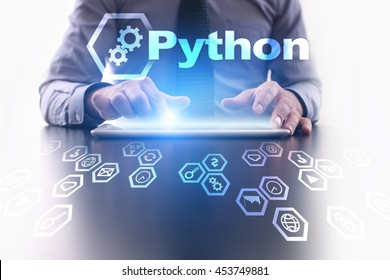 Businessman is using tablet pc and selecting Python icon.