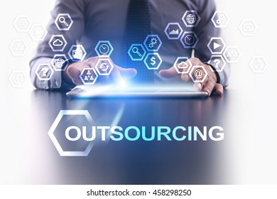 Businessman is using tablet pc and selecting Outsourcing icon.