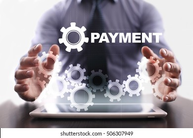 Businessman is using tablet pc and selecting payment