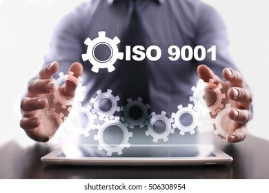 Businessman is using tablet pc and selecting iso 9001