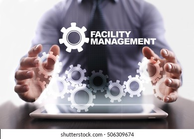 Businessman is using tablet pc and selecting facility management