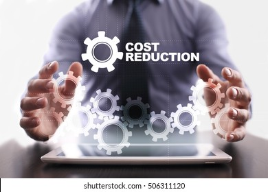 Businessman is using tablet pc and selecting cost reduction