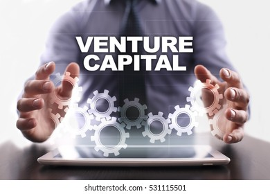 Businessman is using tablet pc and selecting venture capital.