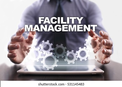 Businessman is using tablet pc and selecting facility management.