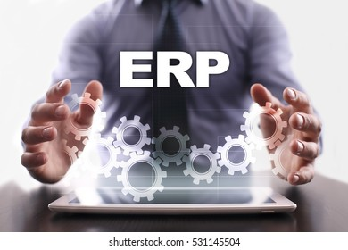 Businessman is using tablet pc and selecting erp.