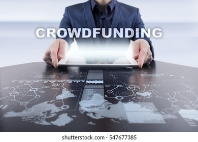 Businessman using tablet pc and selecting crowdfunding.