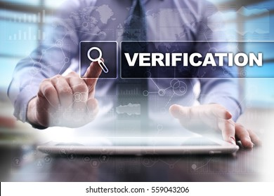 Businessman using tablet pc and selecting verification.