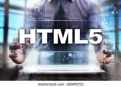 Businessman using tablet pc and selecting html5.