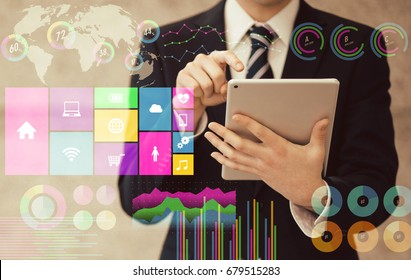 businessman using tablet PC and various business information. paperless office.