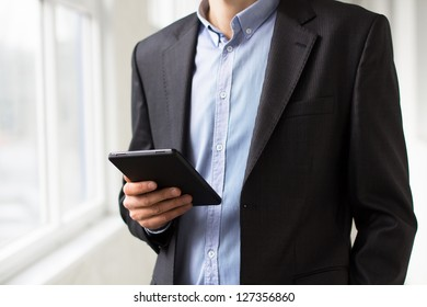 Businessman using tablet pc and works on it