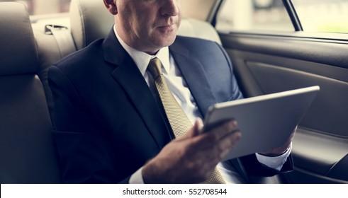 Businessman Using Tablet Working Car Inside