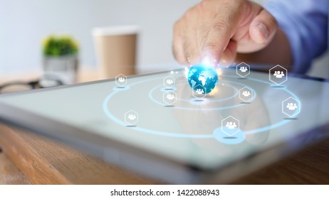 Businessman using tablet. World connected, social network concept