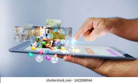 Businessman using tablet. World connected, social media concept