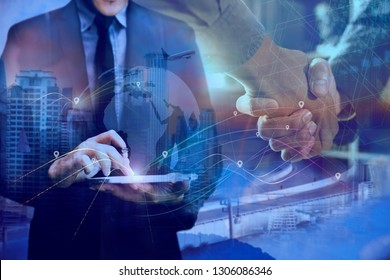 Businessman using tablet and world map with logistic network background, transport concept.