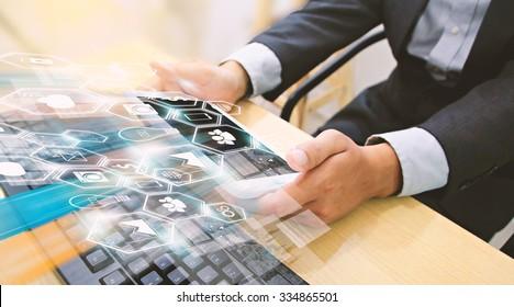 Businessman using tablet,Social media concept.