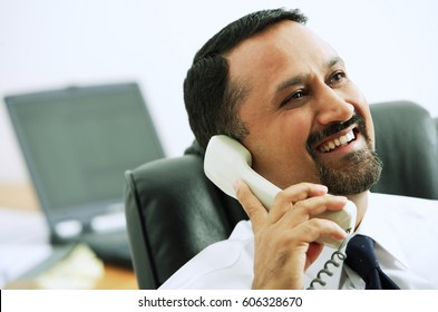 Businessman using telephone, looking away