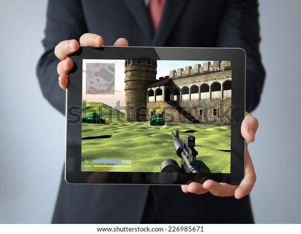 businessman with videogame tablet