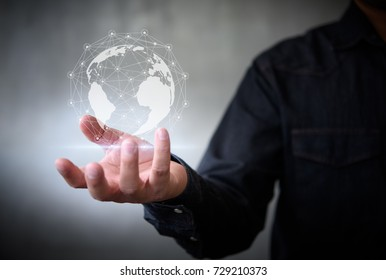 Businessman with virtual Earth map point with network connection on hand, international meaning