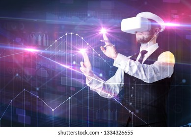 Businessman with virtual reality goggles organizing 3D graphs charts and financial variables