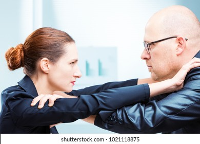 Businessman vs businesswoman face to face confrontation in office
