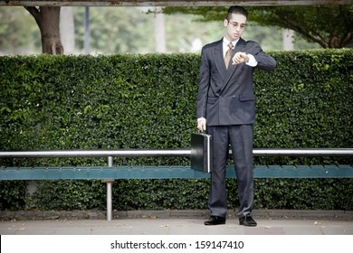 businessman waiting at the bus stop,clean city concept.