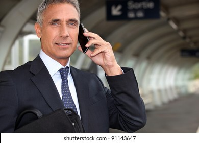 Businessman waiting for a train on the platform