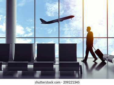 businessman walking in airport  with baggage
