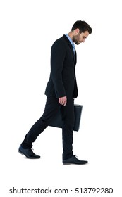 Businessman walking with briefcase on white background