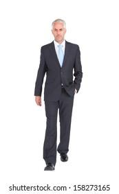 Businessman walking to camera on white background