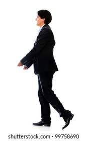 Businessman walking and carrying something - isolated over white