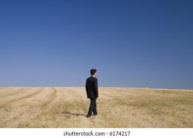 a businessman walking in the field