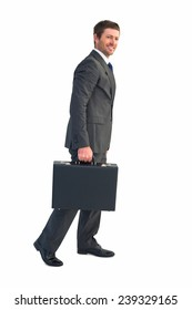 Businessman walking with his briefcase on white background